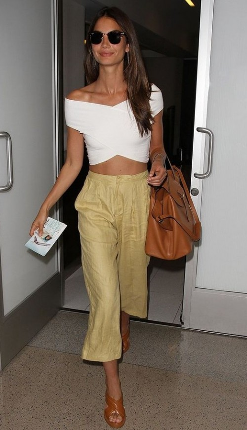Looking for the white off shoulder crop top and  khaki culottes that Lily Aldridge is wearing. - SeenIt