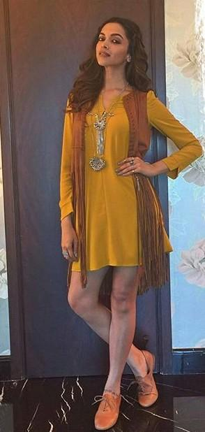 Want this similar mustard yellow dress with fringe tan shrug, tan oxford that Deepika Padukone is wearing - SeenIt