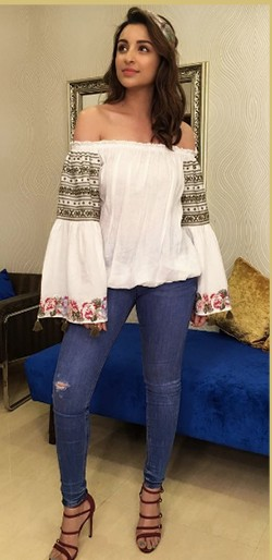 Looking for this white floral off shoulder bell sleeves peasant top, blue skinny jeans, floral hairband and red strappy heels that Parineeti Chopra is wearing - SeenIt