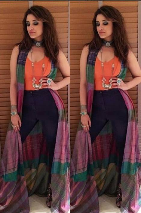 Looking for the orange top, black jeans, silver necklace and black choker that ParineetiChopra is wearing - SeenIt