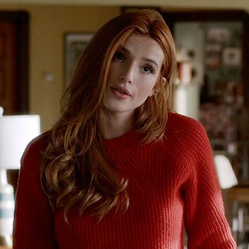 Want a similar tangerine colored pullover that Paige is wearing. - SeenIt