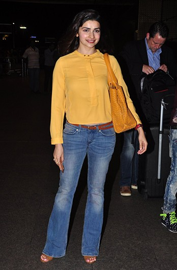 Help me look for a similar mustard top and blue bellbottom jeans as spotted on Prachi Desai - SeenIt