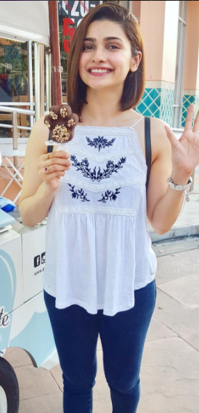 Help me find a similar white and blue summer top with blue jeans as spotted on Prachi Desai - SeenIt
