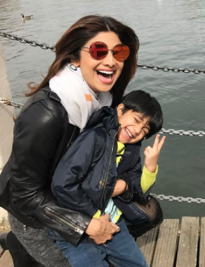 Looking for similar red reflector round sunglasses as spotted on Shilpa Shetty - SeenIt