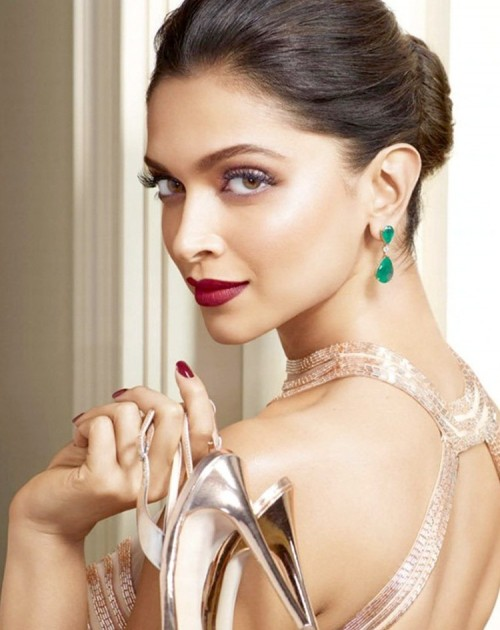 Need a similar maroon lip color and nail paint like Deepika Padukone is wearing at the Cannes pre shoot! - SeenIt