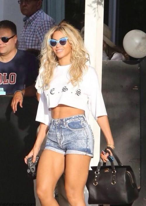 Help me find a similar white crop top and blue denim shorts as the one Beyonce is wearing - SeenIt
