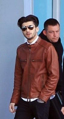 Help me find a similar tan brown leather jacket as Zayn Malik is wearing - SeenIt