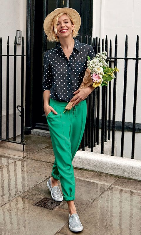 Want Sienna Miller's entire outfit!! Black polka dot shirt, green pants, silver slipons and beige straw fedora hat. - SeenIt