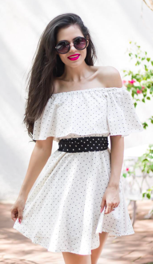I'm looking for a similar black and white polkadot off shoulder dress as seen on AakritiRanaGill - SeenIt