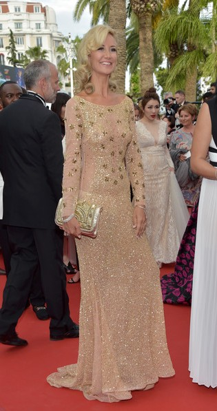 Yay or Nay? Lady Victoria Harvey wearing a golden embellished gown at the Loveless Premiere during the Cannes Film Festival. - SeenIt