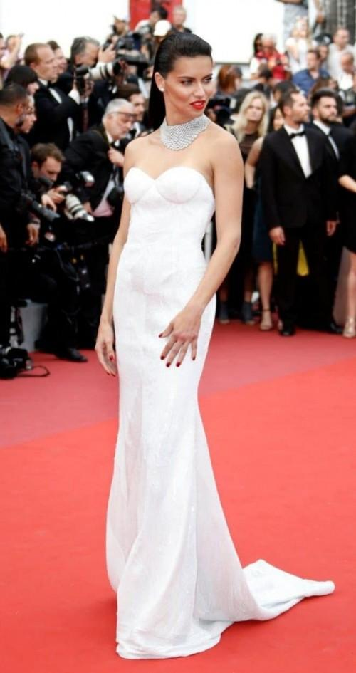 Yay or Nay? Adriana Lima wearing a white strapless gown to the Loveless Premiere during the Cannes Film Festival. - SeenIt