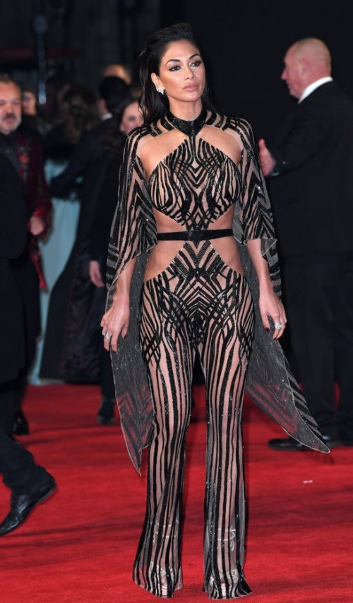 Yay or Nay? Nicole Scherzinger in a sheer black sequin striped cape jumpsuit. - SeenIt