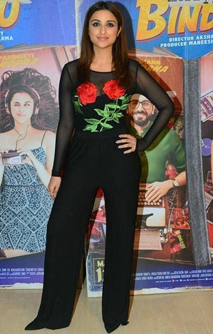 Looking for a similar black sheer embroidered top and black flared pants that Parineeti Chopra is wearing. - SeenIt