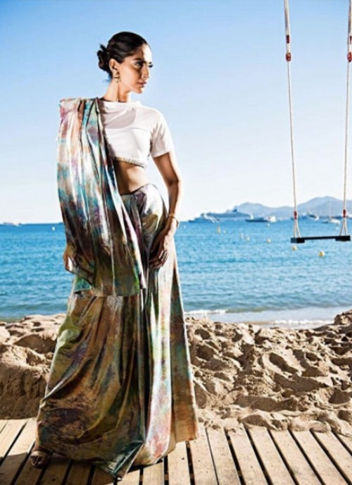 Yay or Nay? Sonam Kapoor wearing a unicorn hued prismatic saree by a label Nor Black Nor White at the Cannes Film Festival - SeenIt