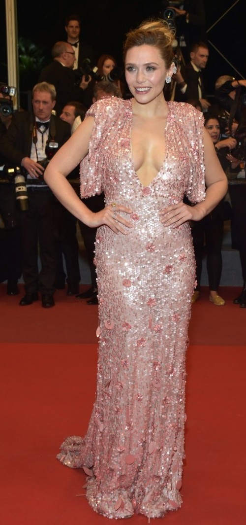 Yay or Nay? Elizabeth Olsen wearing a sequin embellished plunging gown attends the Square screening during the 70th annual Cannes Film Festival - SeenIt