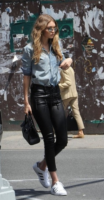 Help me find a similar denim shirt and black leather pants with white sneakers as Gigi Hadid is wearing - SeenIt