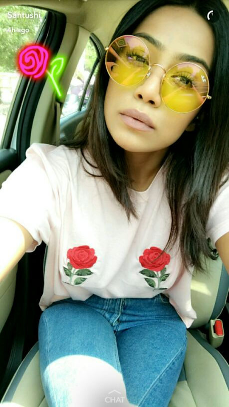 Want the white embroidered t-shirt, blue jeans and round over-sized sunglasses which Santushi Shetty is wearing - SeenIt