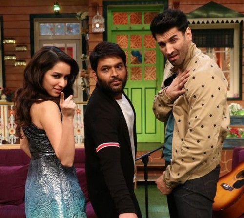 Im looking for similar or same cardigan what kapil is wearing in this episode blue with red stripes - SeenIt