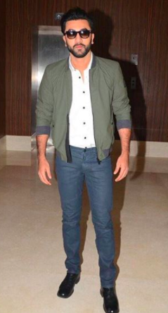 Looking for a similar look with blue pants, white shirt, green jacket, black shoes and black sunglasses as seen on Ranbir Kapoor - SeenIt