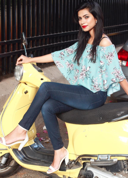 Want the off-shoulder top which Nagmaa is wearing - SeenIt