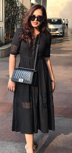I'm looking for a similar black midi dress and black sling bag as seen on styledrive - SeenIt