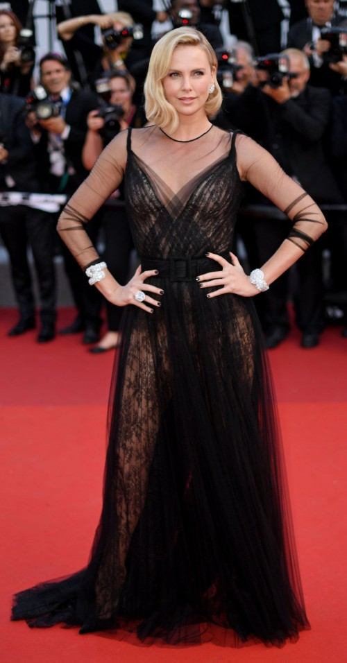 Yay or Nay? Charlize Theron wearing a black shimmer mesh gown at the Anniversary Soiree during the Cannes Film Festival - SeenIt