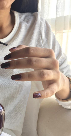 I'm looking for a similar chocolate brown nail paint shade as seen on missstylefiesta - SeenIt