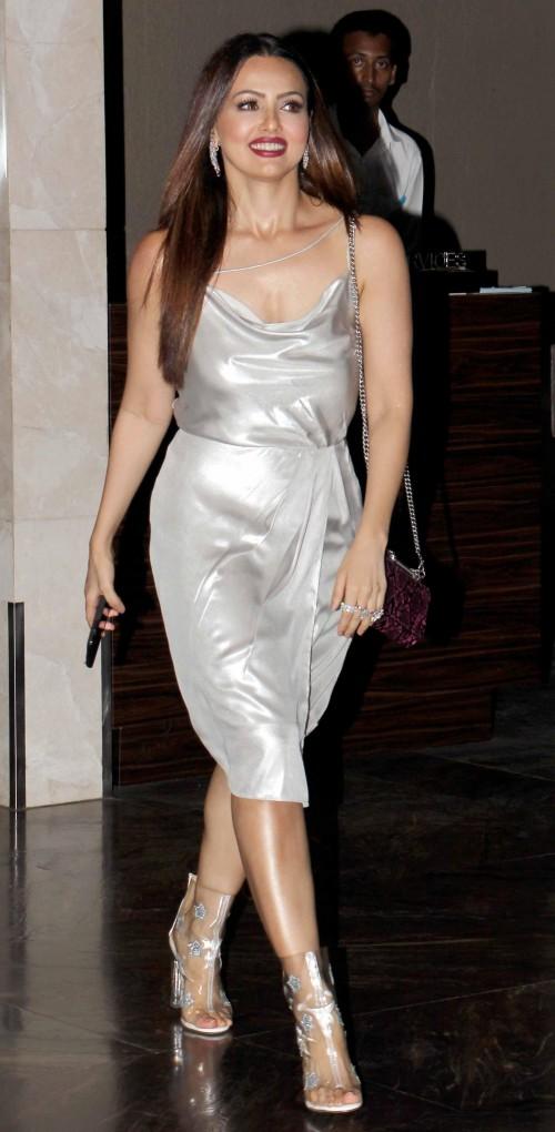 Yay or Nay? Sana Khan wearing a silver cowl neck dress at Zaheer Khan's Engagement party - SeenIt