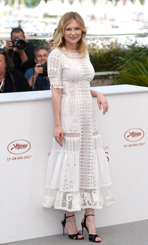 Yay or Nay? Kirsten Dunst wearing a white lace midi dress at The Beguiled Photocall during the Cannes Film Festival - SeenIt