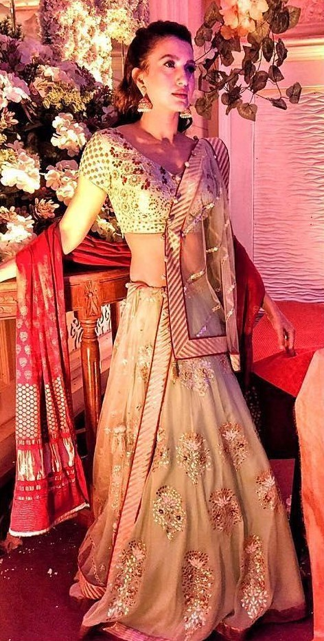 Looking for a similar mint green and red lehenga as seen on Gauhar Khan. - SeenIt
