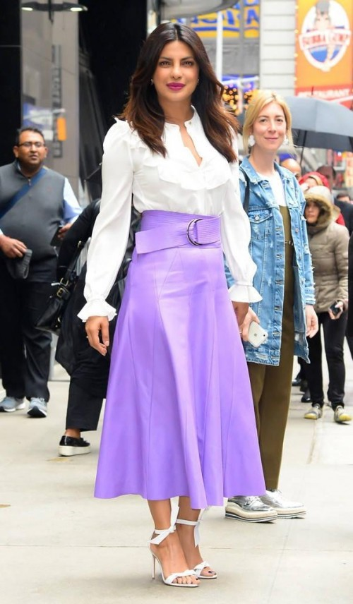 Yay or Nay? Priyanka Chopra wearing a lavender colored leather knee length skirt with a white ruffled top for Baywatch Promotions in New York - SeenIt