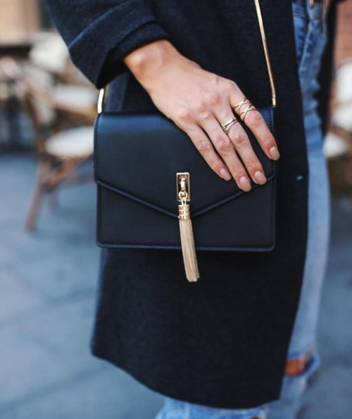 Need this black sling bag with golden tassels!! - SeenIt