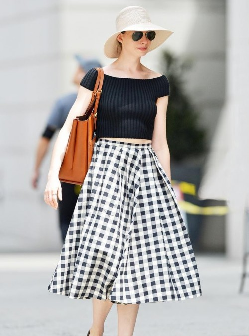 Help me find a similar black off shoulder crop top and black and white checked midi skirt as Anne Hathaway is wearing - SeenIt