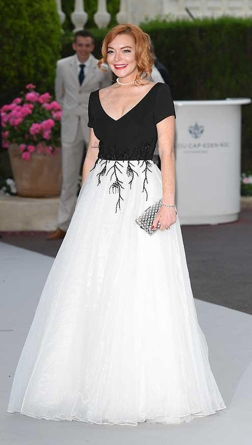 Yay or Nay? Lindsay Lohan wore a floor-length white tulle skirt with embroidered black tee at the Amfar gala during the Cannes Film festival - SeenIt