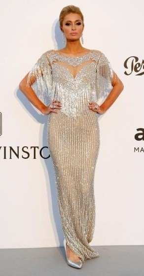 Yay or Nay? Paris Hilton wearing a silver fringe and studded gown at the Amfar Gala during the Cannes Film festival - SeenIt