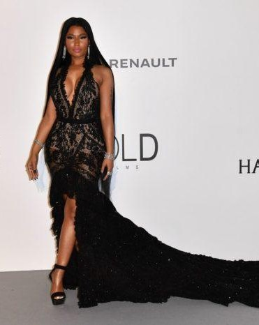 Yay or Nay? Nicki Minaj wearing a black lace trail gown at the Amfar Gala during the Cannes Film Festival - SeenIt