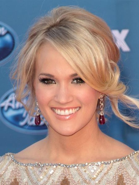 Can you help me find a similar golden earrings with red stones like Carrie Underwood is wearing? - SeenIt