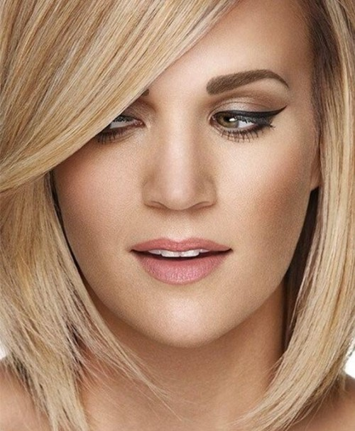 Need the exact peach lipstick like Carrie Underwood is wearing. Also looking for the eyeliner and eye shadow. - SeenIt
