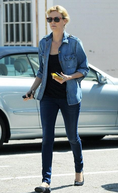 Looking for the denim shirt, black tank top and navy blue jeans that Charlize Theron is wearing. - SeenIt