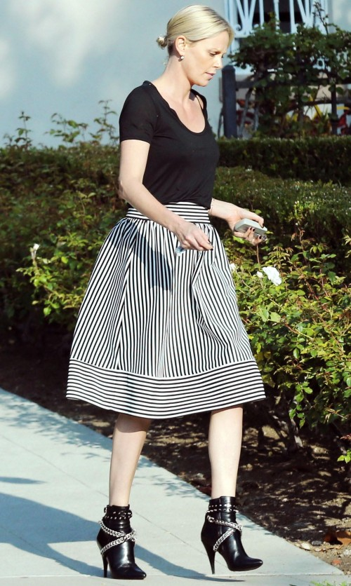 Looking for a similar striped midi skirt and black top that Charlize Theron is wearing. - SeenIt