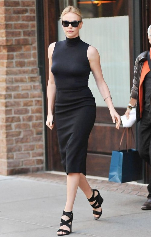 Looking for this black bodycon midi dress that Charlize Theron is wearing. - SeenIt