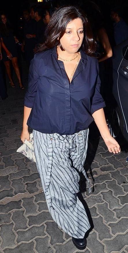 Yay or Nay? Zoya Akhtar spotted wearing a blue shirt and drape pants at Karan Johar's Birthday party - SeenIt