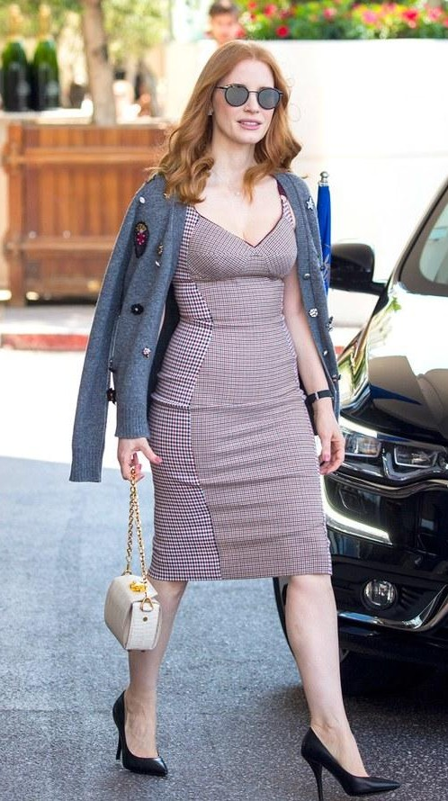 Yay or Nay? Jessica Chastain spotted wearng a bodycon dress with a chic pullover on day 10 during the Cannes Film Festival - SeenIt