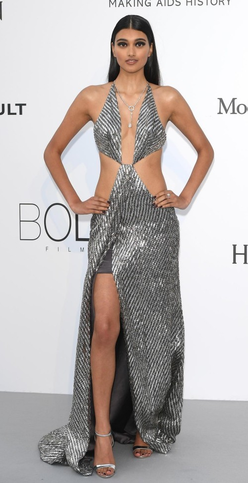 Yay or Nay? Neelam Gill wearing a silver cut out gown at the Amfar Gala during the Cannes Film Festival - SeenIt