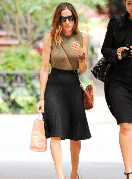 Looking for a similar black skirt and olive green top as the one Sarah Jessica Parker is wearing - SeenIt