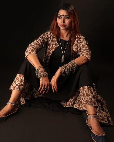 Looking for this black kurta with brown and off white ajrakh printed cape and palazzo. - SeenIt