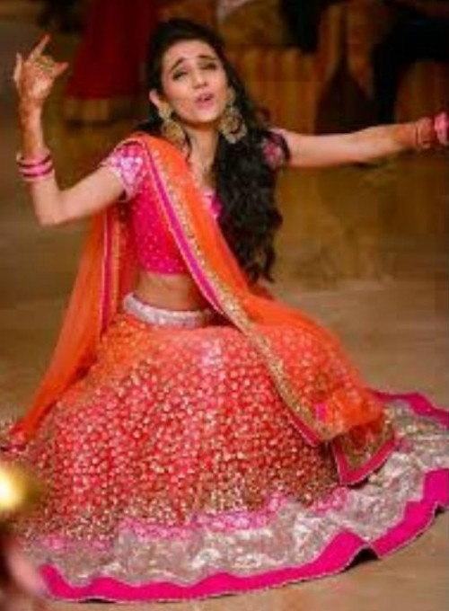 Looking for the orange red lehenga with similar work that miss stylefiesta wore! - SeenIt
