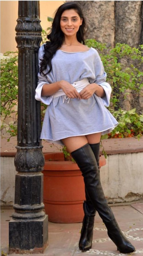 Looking for similar light blue dress and long tall boots which Pernia Qureshi is wearing - SeenIt