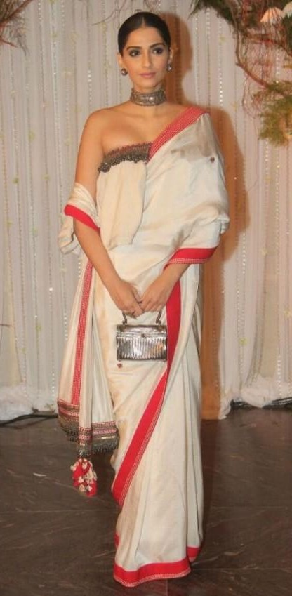 fa813f772d8 Looking for a similar cream saree with a tube ruffled blouse as seen on Sonam  Kapoor