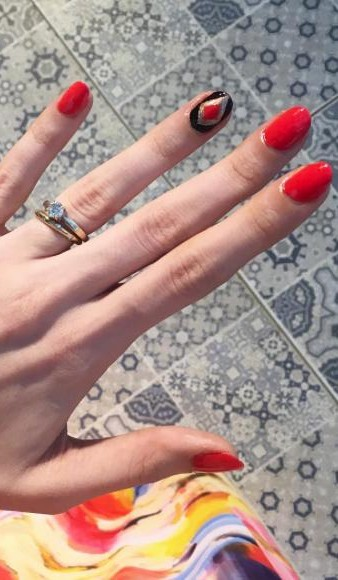 I'm looking for a similar cherry red, black and golden nail paint as seen on sherryshroff - SeenIt